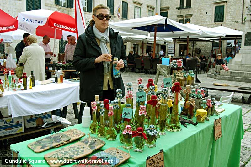 Grappa seller at Dubrovnik market