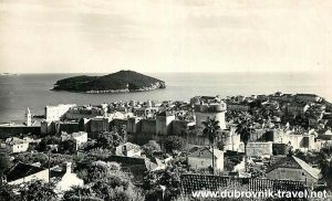 Medieval town walls of Dubrovnik with Lokrum island in the background