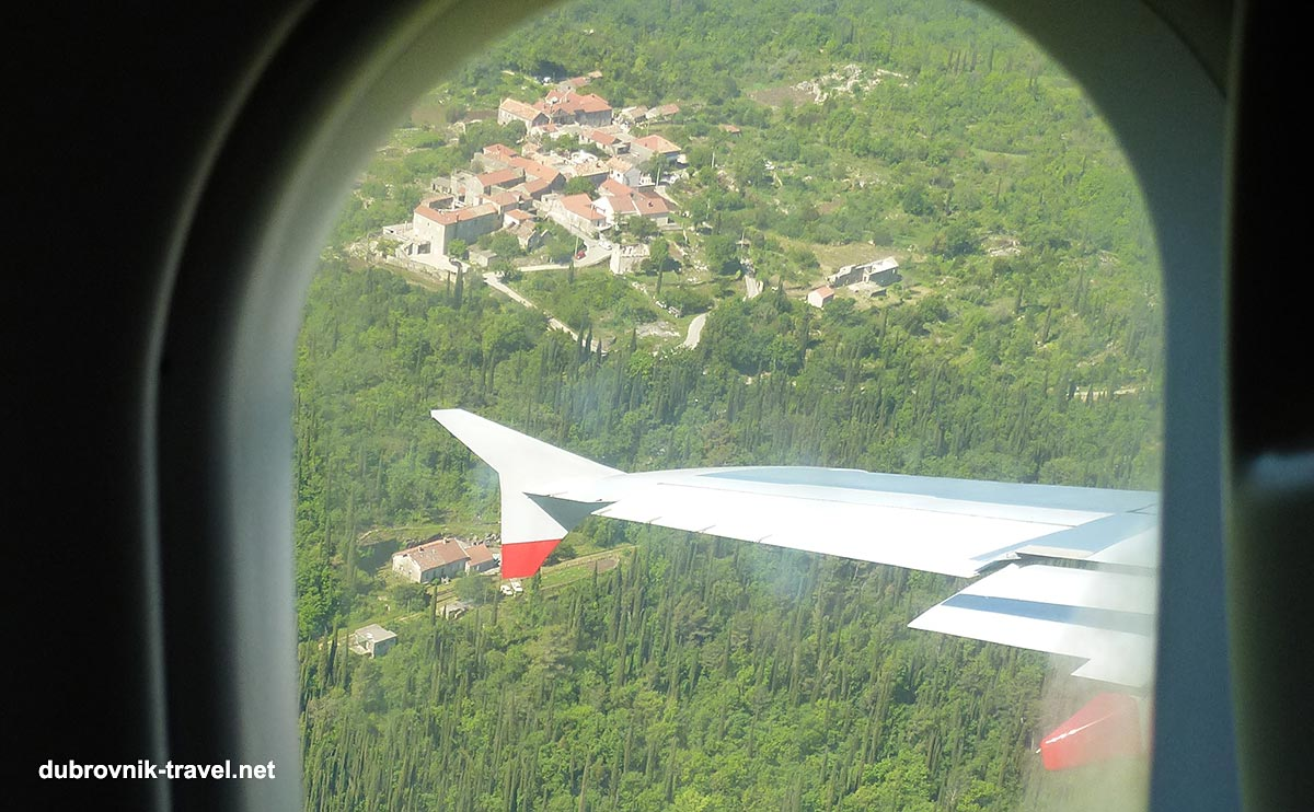 Views through the small aeroplane window just minutes before landing