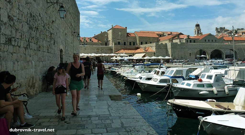 old port of dubrovnik with boats and cool promenade