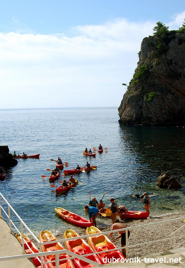 A group of kayakers paddling back to base in Dubrovnik's Sulic beach